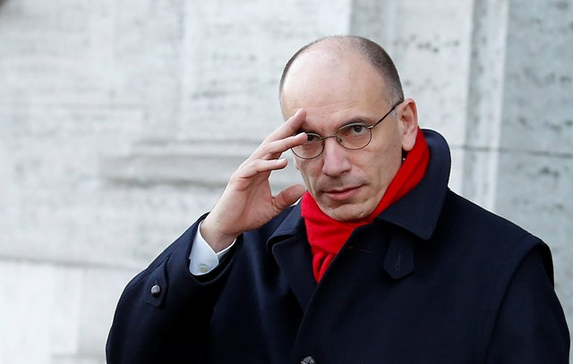 Italy's Prime Minister Enrico Letta gestures as he leaves his house in downtown Rome February 14, 2014. Italian centre-left leader Matteo Renzi forced party rival Letta to resign as prime minister on Thursday after criticizing his government's failure to pass major reforms, opening the way for Italy's third administration in a year. REUTERS/Remo Casilli  (ITALY - Tags: POLITICS PROFILE TPX IMAGES OF THE DAY)