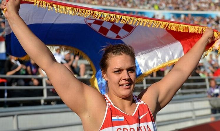Croatia's Sandra Perkovic celebrates aft