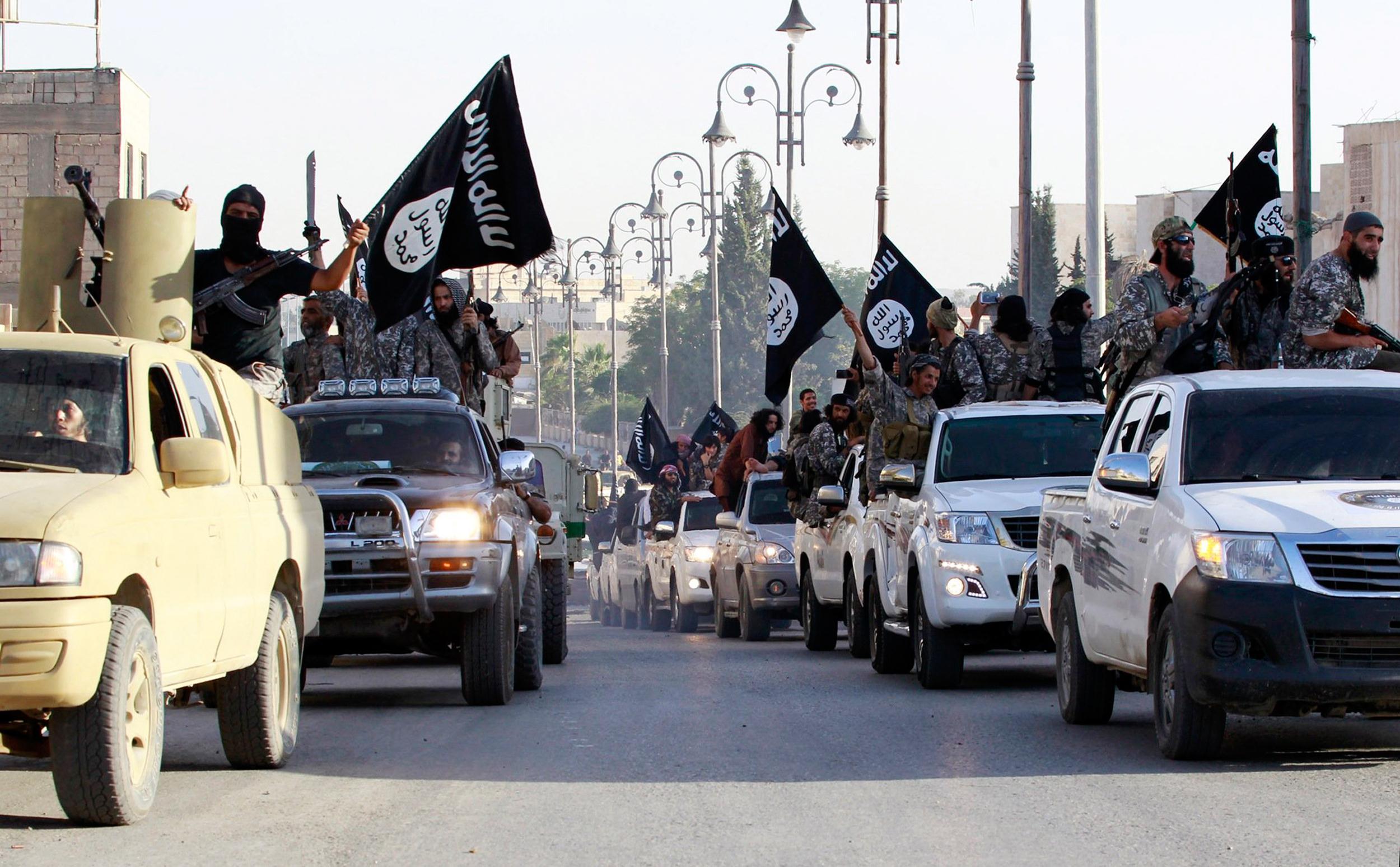 140702-syria-isis-parade-raqqa-1053a_319361e42828771c967a349960c81eab